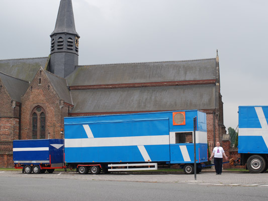 A man between trucks and church